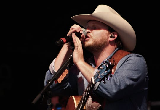 Josh Abbott didn't need to warm up the crowd on a warm evening for headliner Aaron Watson, instead delighting his fans with favorite tunes and news ones at the Taylor County Expo Center on Friday evening.