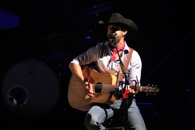 """Aaron Watson took a seat for a few acoustic songs Friday evening, including """"Bluebonnets (Julia's Song),"""" in his first show in Abilene since January 2018. Watson, who lives outside of the city, debuted his """"Red Bandana"""" album."""