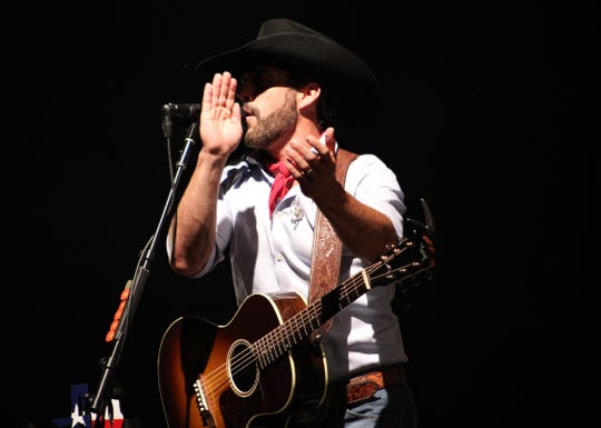 Country singer Aaron Watson gets fans to clap during his concert at the Taylor County Expo Center on June 28.