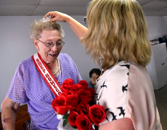 Wanda Maddox tilts her head as Sharon Scott places a tiara on her head June 22,. Maddox was voted the 2019 Shep Homecoming queen.