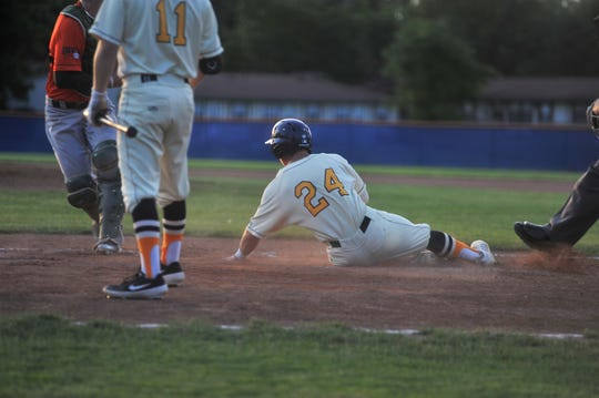 Galion Graders third baseman Ryan Strittmather looks at the umpire after being called out sliding into home.