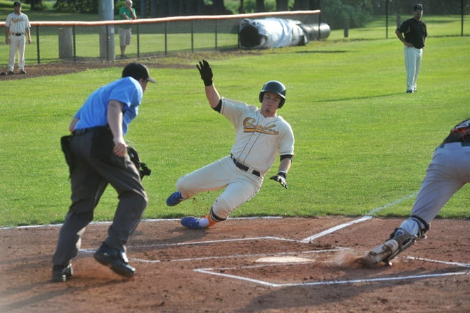 Bryce Ray slides into home for the Galion Graders against the Southern Ohio Copperheads.