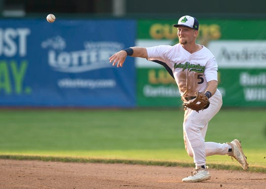 Vermont Lake Monsters' second baseman Nick Ward fires to first for an out against the Connecticut Tigers during a game at Centennial Field on Wednesday, June 26, 2019.