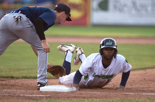 The Vermont Lake Monsters' Danny Bautista is safe under the tag at first base against the Connecticut Tigers during a game at Centennial Field on Wednesday, June 26, 2019.