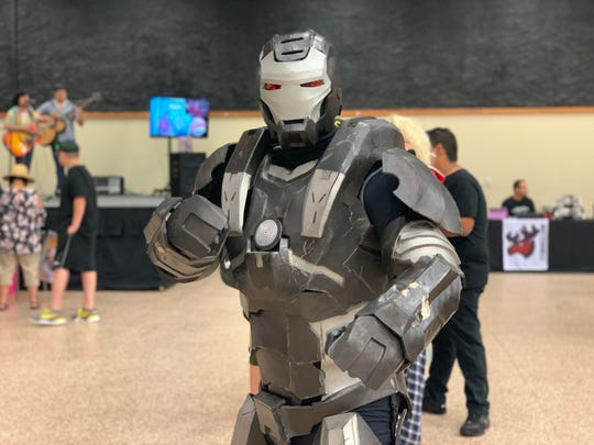 "Edgar Cantu, who is dressed as Marvel's ""War Machine,"" poses at the third annual Corpus Christi Comic Con on Saturday, June 29, 2019."