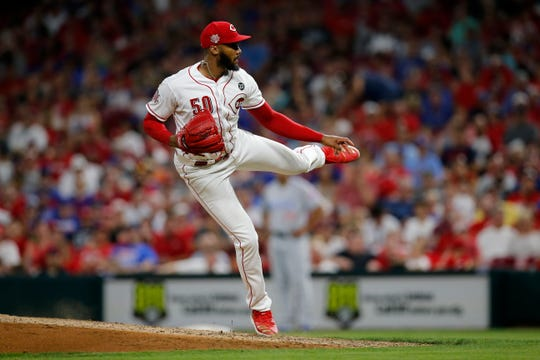 Cincinnati Reds relief pitcher Amir Garrett (50) delivers a pitch in the eighth inning of the MLB National League game between the Cincinnati Reds and the Chicago Cubs at Great American Ball Park in downtown Cincinnati on Friday, June 28, 2019. The Reds won the first game of the three-game series, 6-3.