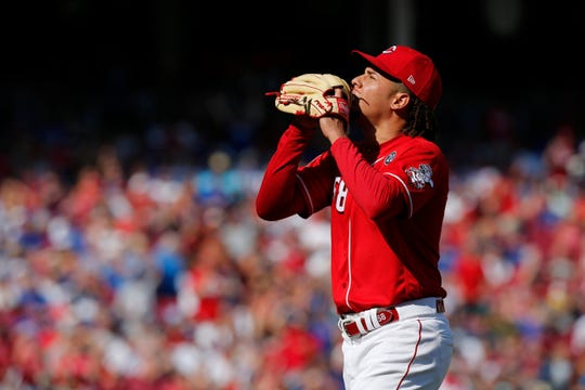 Cincinnati Reds starting pitcher Luis Castillo (58) celebrates as returns to the dugout after the top of the fifth inning of the MLB National League game between the Cincinnati Reds and the Chicago Cubs at Great American Ball Park in downtown Cincinnati on Saturday, June 29, 2019. The Cubs led 1-0 after five innings.