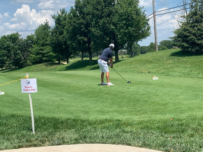 University of Dayton golfer Domenic Mariccochi tees off in his semifinals match at Oasis Golf Club
