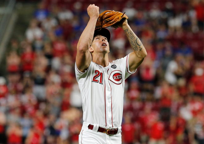 Cincinnati Reds relief pitcher Michael Lorenzen (21) celebrates after the final out of the ninth inning of the MLB National League game between the Cincinnati Reds and the Chicago Cubs at Great American Ball Park in downtown Cincinnati on Friday, June 28, 2019. The Reds won the first game of the three-game series, 6-3.