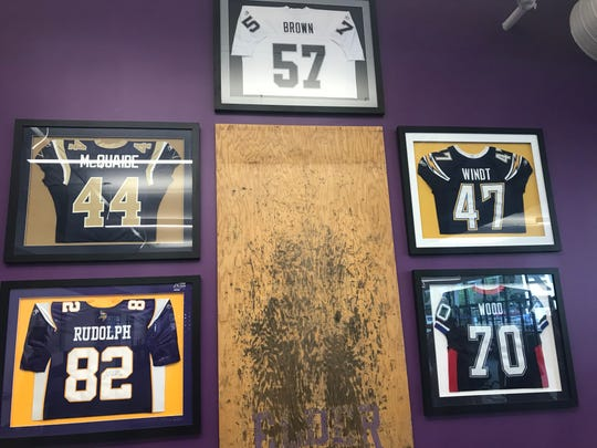 Elder's new weight room features jerseys of past and current Elder Alumni in the NFL, including Kyle Rudolph (Minnesota Vikings), Jacob McQuaide (Los Angeles Rams), Ricky Brown (Oakland Riaders), Mike Windt (Los Angeles Chargers) and Eric Wood (Buffalo Bills)