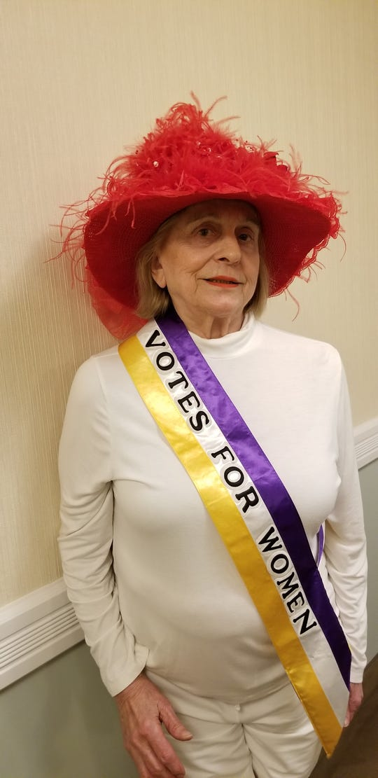 Mary Anne Christie wears the sash that will be worn at the Reds-Indians game on July 6.