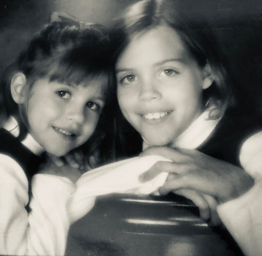 Micalla Rettinger, left, shown with her older sister, Maria, when the two were children in 1998. Micalla Rettinger, 25, was beloved sister and friend and a star softball player in the Kansas City area then at Northern Iowa. She was shot and killed April 28, 2019.