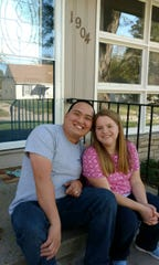 Sam and Holly Swinton outside their new home in West Des Moines.