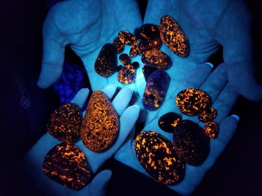 Yooperlites are fluorescent, sodalite-rich syenite rocks found in Michigan's Upper Peninsula.