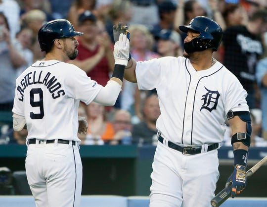 Detroit Tigers' Nicholas Castellanos celebrates with Miguel Cabrera after hitting a solo home run against the Washington Nationals during the fifth inning Friday, June 28, 2019, in Detroit.