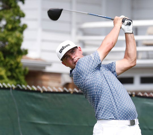 Gary Woodland hits his tee shot on the 8th hole Friday.