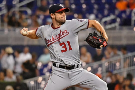 Max Scherzer delivers a pitch in the second inning against the Marlins on Tuesday.