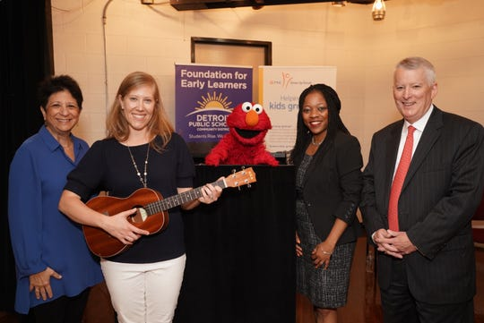 From left: Dr. Rosemarie Truglio, SVP Curriculum and Content for Sesame Workshop, Detroit Symphony Orchestra Teaching Artist Sarah Boyd, Iranetta Wright, Deputy Superintendent, Detroit Public Schools Community District and Ric DeVore, Regional President for Detroit and Southeastern Michigan, PNC Bank pose with Elmo at Fleming Early Learning Neighborhood Center in Detroit on June 20, 2019.