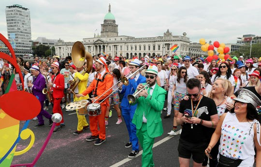 People take part in the Pride parade in Dublin, Saturday June 29, 2019