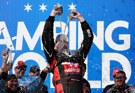 Cole Custer celebrates with his crew in Victory Lane after winning the NASCAR Xfinity Series race at Chicagoland Speedway on Saturday.