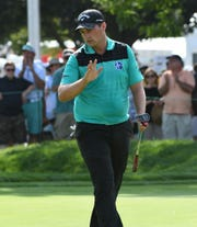 Brian Stuard reacts after making a putt for birdie on the second hole Saturday.