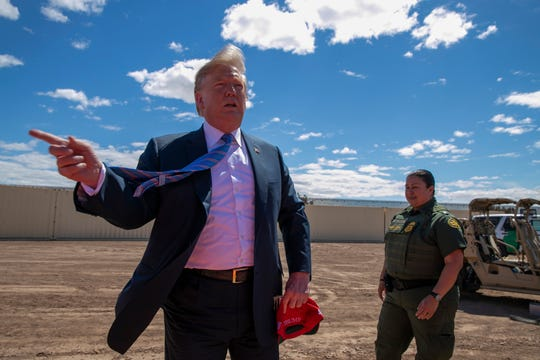 President Donald Trump speaks as he visits a new section of the border wall with Mexico in Calexico, Calif. on April 5, 2019.