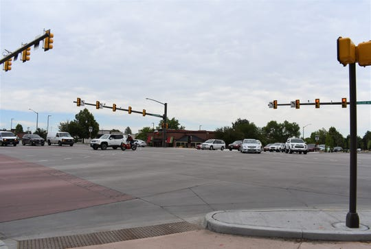 Vehicles make left-hand turns at the newly upgraded intersection at Horsetooth Road and College Avenue on Wednesday.