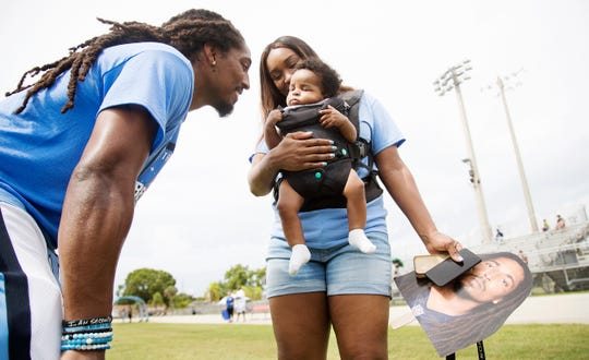 """North Fort Myers High graduate and NFL safety Tre Boston enjoys time with his wife Cierra and 2-month-old son, Tre Jr., on Saturday at his football camp in North Fort Myers. More than 100 kids attended the annual camp which is part of Boston's Beyond Belief Foundation that benefits Southwest Florida youth. """"He's his sideline inspiration,"""" Cierra says of Tre Jr."""