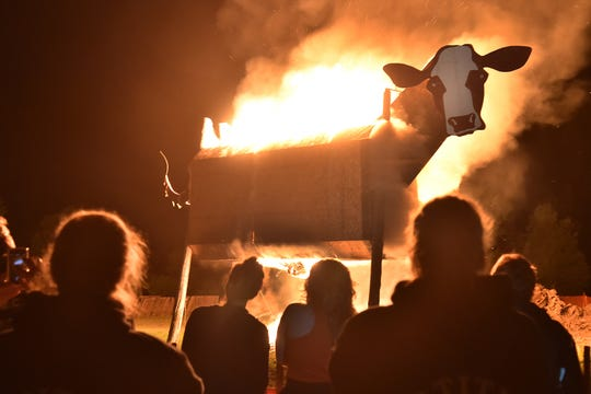 The ceremonial torching of a 30-foot-tall, wooden cow marks the conclusion of the Burning Cow Music Festival. The three-day rock concert and camping festival takes place July 18 to 20 just north of Sturgeon Bay.