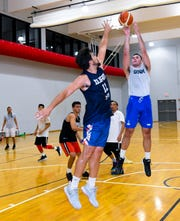Seve Sussuico, front, goes up against Mike Sakazaki during a practice game at the GBC National Training Center in Tiyan on Wednesday, June 26, 2019.