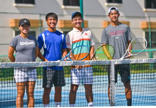 Coach Michelle Pang, left, gathers with tennis team members, Camden Camacho, Derek Okuhama and Mason Caldwell, at the Ypao Gardens tennis courts in Tamuning June 29. Not pictured is Danny Llarenas.