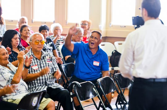 Victor Duenas is applauded by audience members after pointing out that only a few island leaders were in attendance during an omnibus town hall meeting, hosted by Guam Del. Michael San Nicolas, at the Inarajan Community Center on Saturday, June 29, 2019.