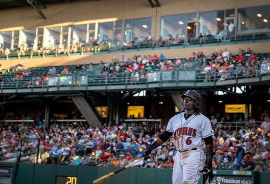 Trayvon Robinson has restarted his baseball career as an outfielder for the Indianapolis Indians. Here he warms up behind home plate during a game against the Louisville Bats at Victory Field in Indianapolis on June 25.
