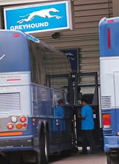Passengers arrive and depart outside the terminal of the Greyhound bus station, Monday, June 29, 2015, Indianapolis, Ind.