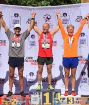 Brent Bueche (center) celebrates with his gold medal at the 2019 National Senior Games in Albuquerque, NM.