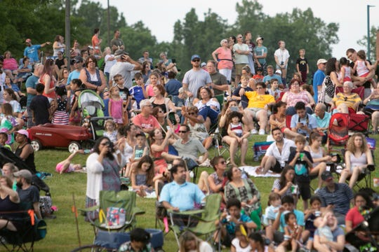 Crowds surround the launch field as balloonists fill their balloons with hot air and take off Friday, June 28, 2019, the first night of the 35th annual Michigan Challenge Balloonfest.