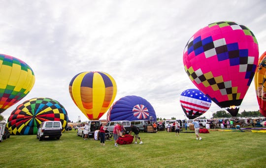 Pilots fill their balloons for the first launch of the Michigan Challenge Balloonfest Friday, June 28, 2019.