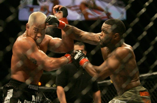 Rashad Evans, right, punches Tito Ortiz, during their light heavyweight fight at the Ultimate Fighting Championship UC 73 on Saturday, July 7, 2007, in Sacramento, Calif. The fight ended in a draw.