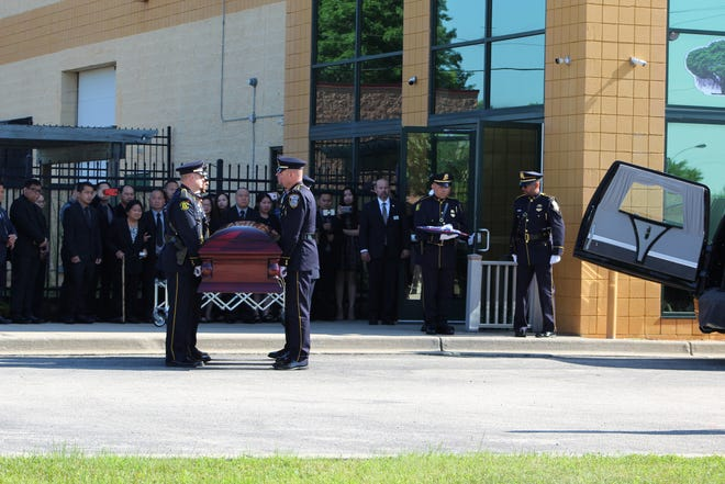 Officers carry the casket of Milwaukee Police Officer Kou Her, who was killed June 18, 2019, when his car was struck by a suspected drunken driver.