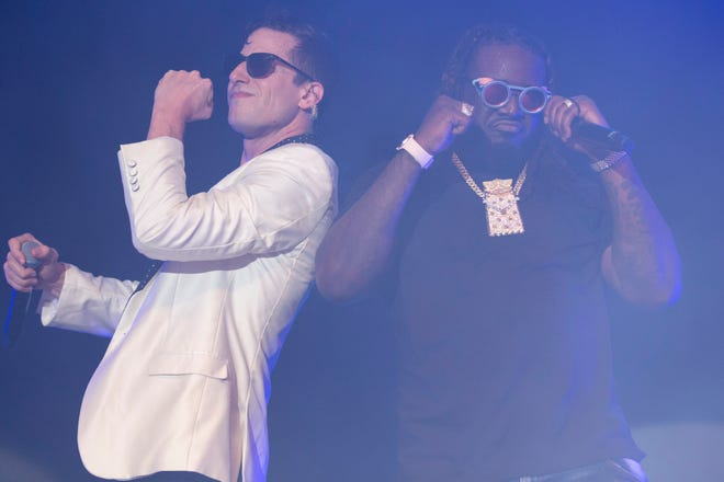 "Rapper T-Pain (right) joins Andy Samberg (left) and The Lonely Island for their viral hit collaboration ""I'm on a Boat"" during Lonely Island's set at Summerfest's Miller Lite Oasis Friday night."