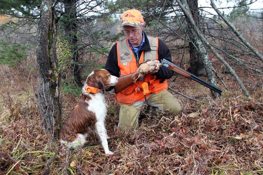 Gary Zimmer of Rhinelander, Wis. is shown with Scout, his Brittany, during a 2012 grouse and woodcock hunt in northern Wisconsin. Zimmer served from 2013 to 2019 on the Natural Resources Board; his term ended Wednesday.