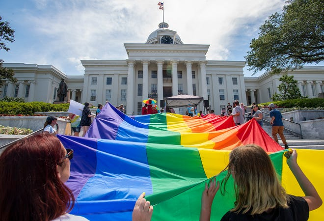 Marchers carry a giant rainbow flag up the steps of the Alabama Capitol Building during the Montgomery Pride March and Rally in downtown Montgomery, Ala., on Saturday June 29 , 2019.