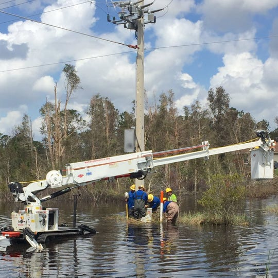 LCEC crews work to restore a power line after a storm.