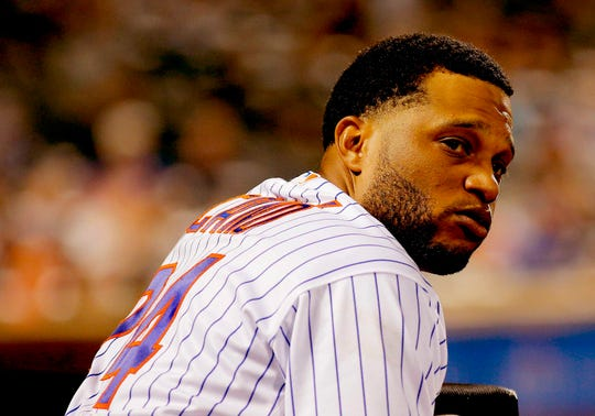 New York Mets second baseman Robinson Cano (24) looks on from the dugout against the Atlanta Braves during the  inning at Citi Field.