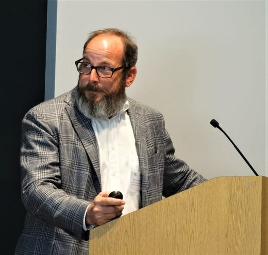 Morris Friedman, CEO of Friedman Recycling, explains during his presentation at the NMRC's regional workshop how contamination like food waste is the number one problem for recycling processors.