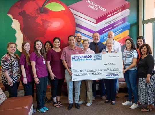 The Aprendamos Intervention Team and Direct Therapies Center presented a $15,000 check Wednesday to two departments in the College of Education at New Mexico State University. The Communication Disorders department received $10,000, while the Department of Counseling and Educational Psychology received $5,000. The check presentation marked the first time in 12 years that Aprendamos has donated to the Counseling and Educational Psychology department.