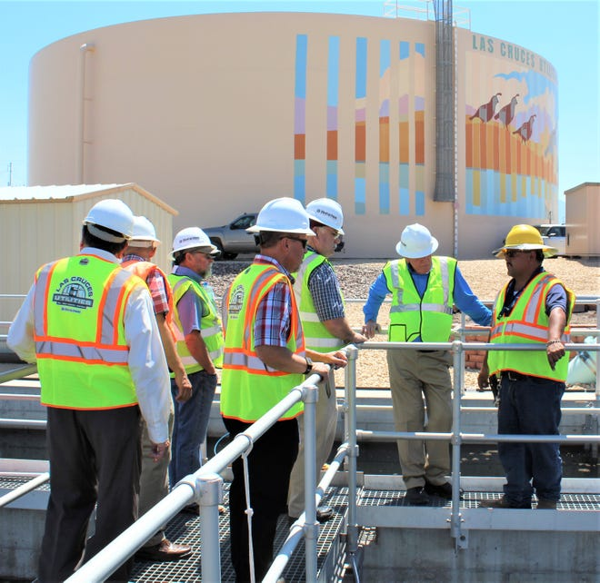 CIAC Chair William Beerman and members Mark O'Neill, Jason Lorenz, and Eugene Suttmiller examine the wastewater processing pools at the East Mesa Water Reclamation Facility. The members toured some of the LCU facilities to get a better sense of the infrastructure that capital funds help to support.