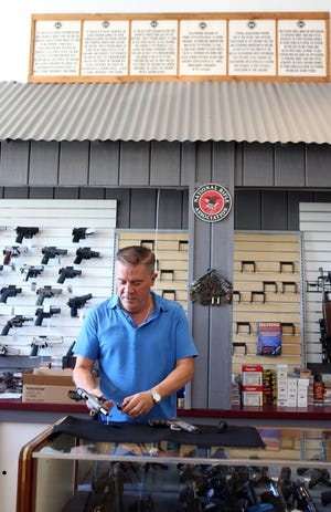 Guns of Distinction President Storm Jenkins inside the Palm Desert firearms shop in June 2019.