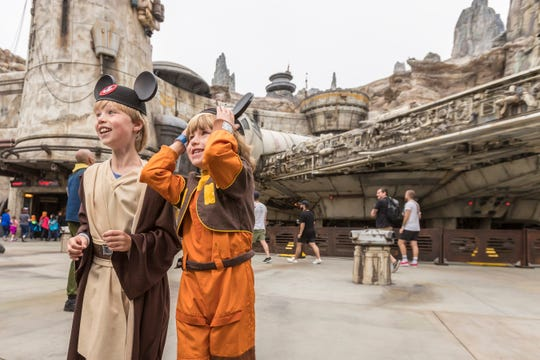 Brothers Bobby and Thor, of San Rafael, Calif., were among the first guests to arrive at Star Wars: Galaxy's Edge at Disneyland Park in Anaheim, California, on opening day, May 31, 2019. Star Wars: Galaxy's Edge is Disney's largest single-themed land expansion ever at 14-acres, transporting guests to Black Spire Outpost, a village on the planet of Batuu.