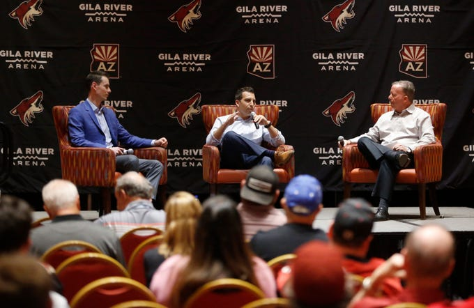 Coyotes President Ahron Cohen (center) and GM John Chayka answer questions from Matt McConnell (R) at Renaissance Phoenix Glendale Hotel & Spa in Glendale, Ariz. on June 28, 2019.